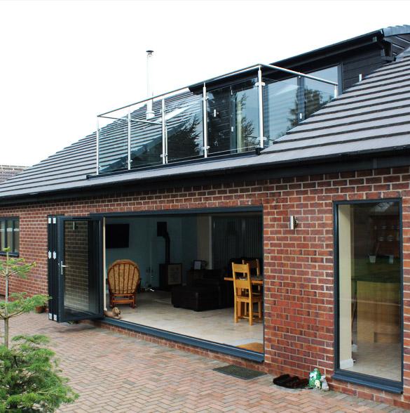 Dorma loft conversion and patio